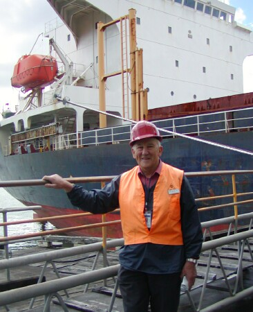 Chaplain David Millar about to board a ship at Chelsea Sugar Wharf