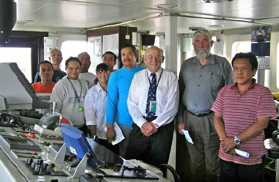 Chaplain David Millar (Centre) with Captain Commons and crew of BALTIMAR BOREAS after memorial service for the late father of one of the crew Dec 2005 (Photo thanks to Captain Mike Wade, Baltimar NZ)